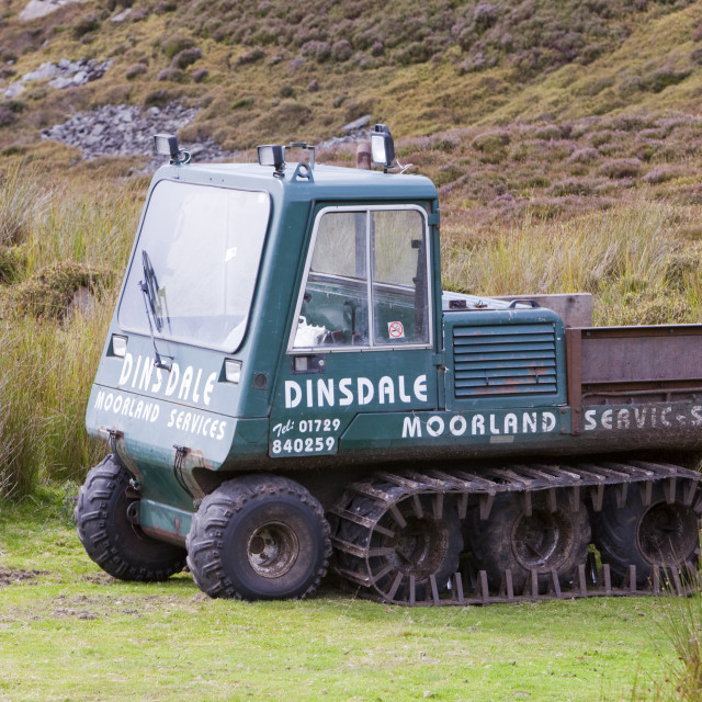 """A tracked vehicle being used by a specialist moorland restoration company to..."" stock image"