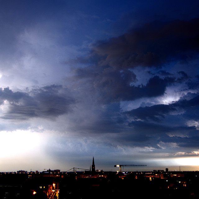 """Nocturnal thunder storm over the city of Antwerp, Belgium"" stock image"