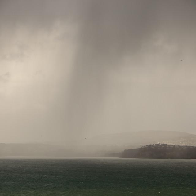 """Rain showers over the Cornish coast near St Austell, UK."" stock image"