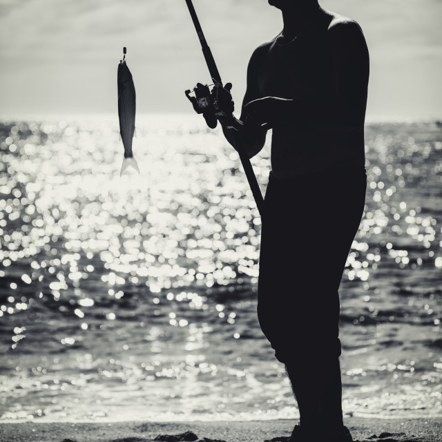 """Fishermen on the beach"" stock image"