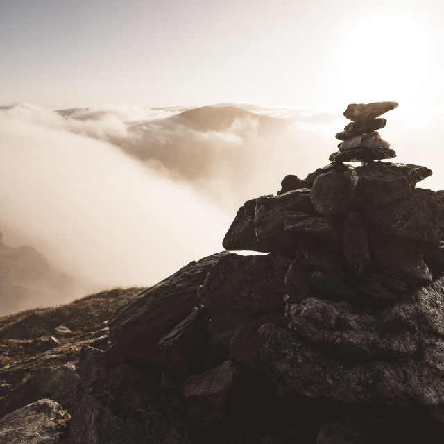 """""""Summit Above The Clouds"""" stock image"""