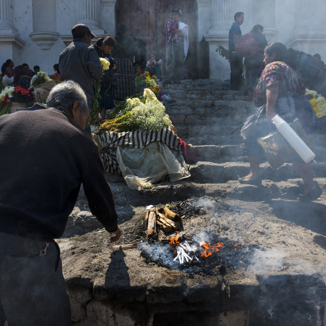 """Chichicastenango, Guatemala - April 24, 2014: Man performing an ancient Maya ritual in the stairs of the Santo Tomas Church (Iglesia de Santo Tomas) in the town of Chichicastenango, in Guatemala."" stock image"