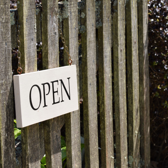 """Open sign on rustic wooden gate."" stock image"