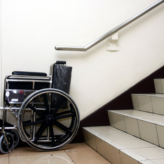 """A wheelchair and a set of staircase."" stock image"