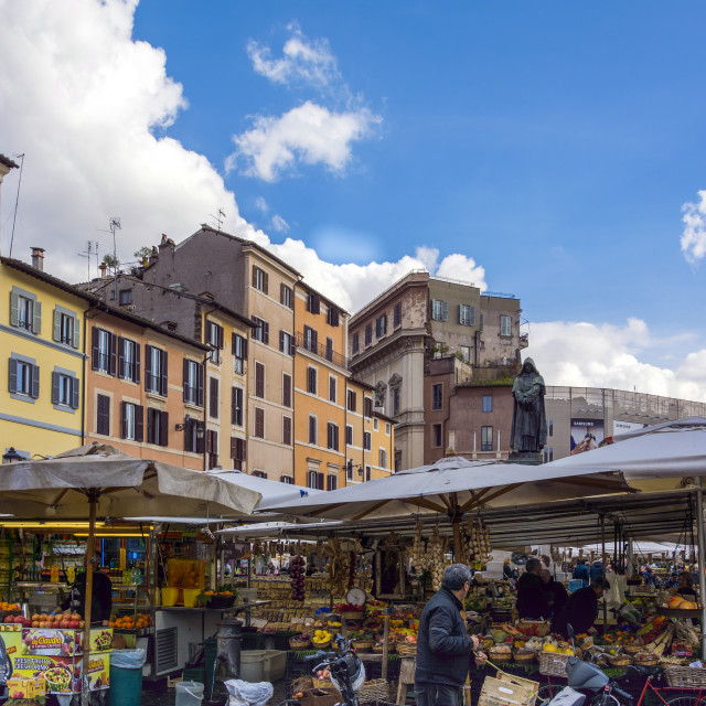 """Rome, Italy february 11th, 2017: market with unidentified people on the Campo de Fiori on february 11, 2017 in Rome.1869 the flower market of the famous Piazza Navona was relocated to the Campo de Fiori"" stock image"