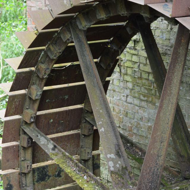 """Iron water wheel."" stock image"