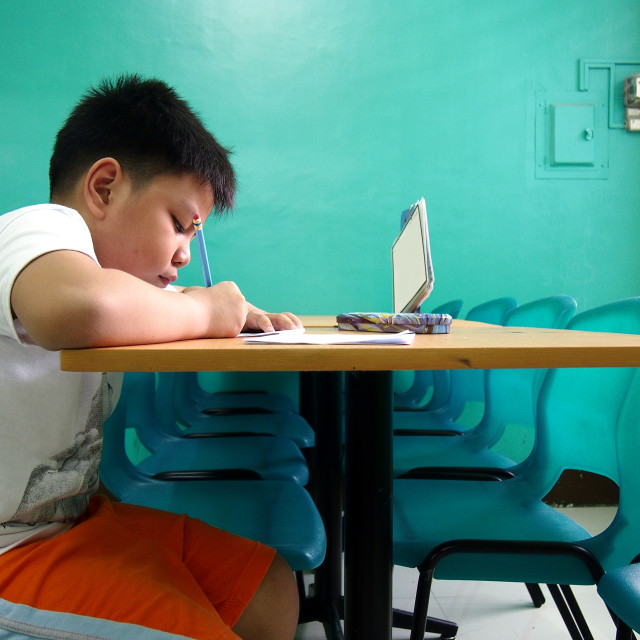 """Young kid writing on a table"" stock image"