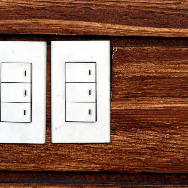 """Light switches on a concrete wall"" stock image"