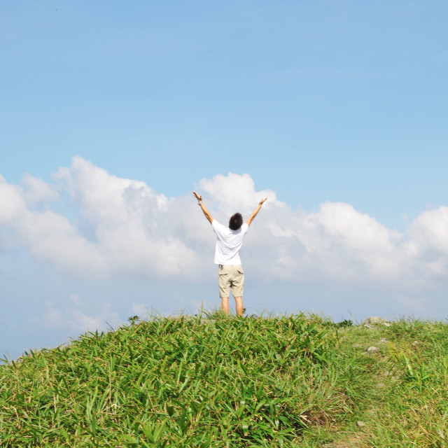 """""""Meeting of the sky. The man on high mountain with the hands lifted above, on..."""" stock image"""