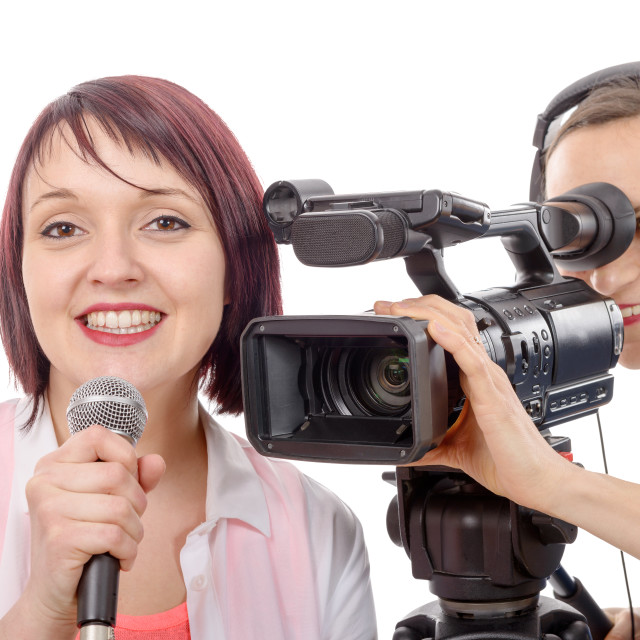"""""""young woman journalist with a microphone and camerawoman"""" stock image"""