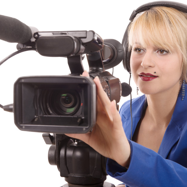 """""""beautiful young woman with a professional video camera and headphone"""" stock image"""