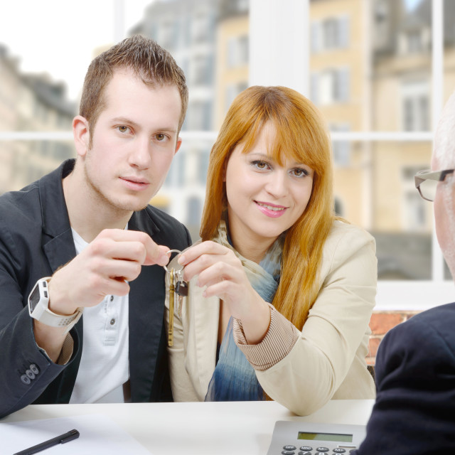 """""""a young couple buys a house"""" stock image"""