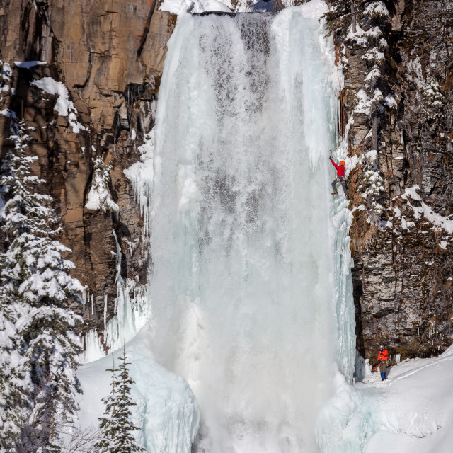 """Ice Climbers Scale Frozen Waterfall"" stock image"