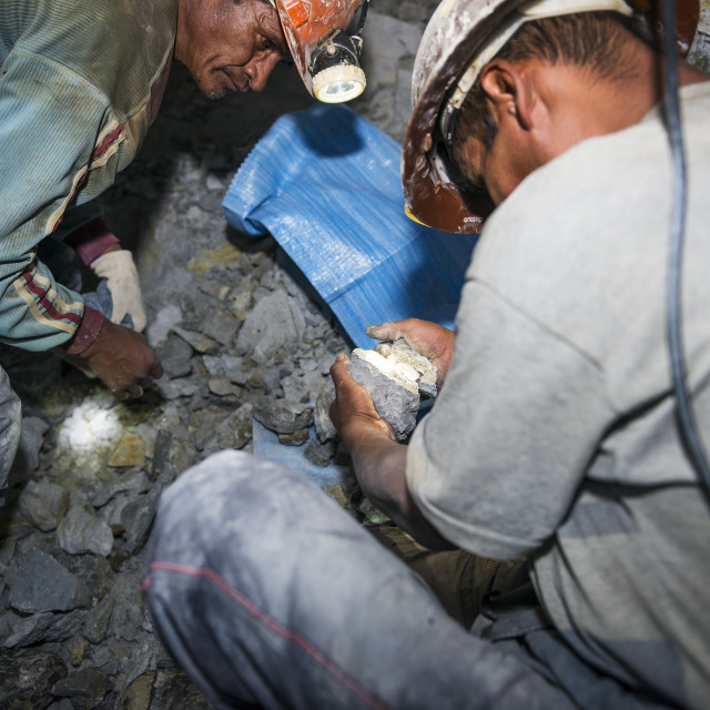 """Potosi, Bolivia - November 29, 2013: Two miners looking for silver in the silver mine of the Cerro Rico in Potosi, Bolivia."" stock image"