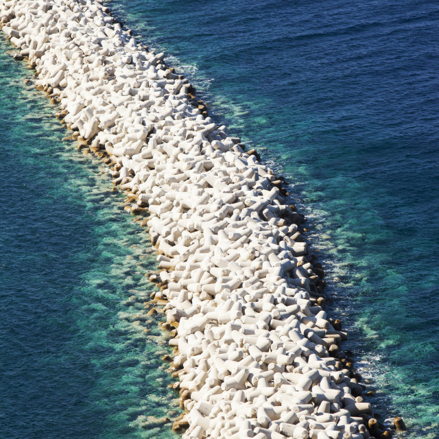 """Concrete interwoven blcosk used as a breakwater at the entrance to Myrina..."" stock image"