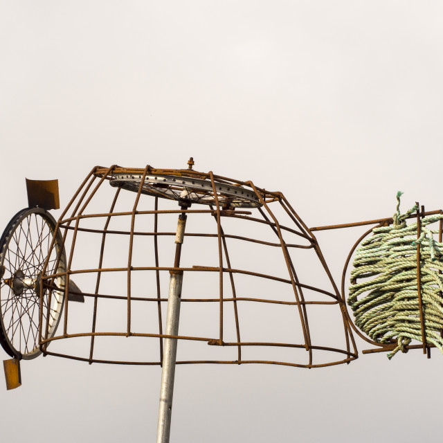 """""""A querky home made wind turbine in a garden in Port Isaac."""" stock image"""