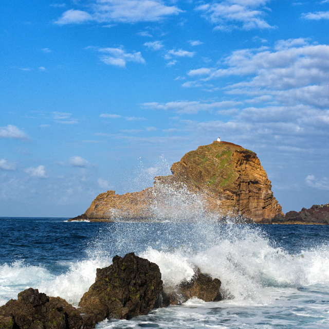 """""""lighthouse and rock in porto moniz in madeira"""" stock image"""