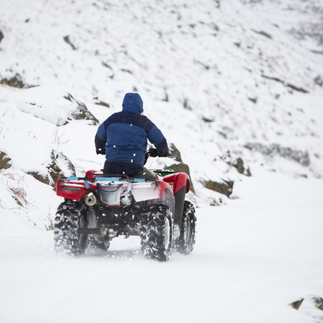 """""""A farmer using a quad bike to get down Wrynose Pass in the Lake District that..."""" stock image"""