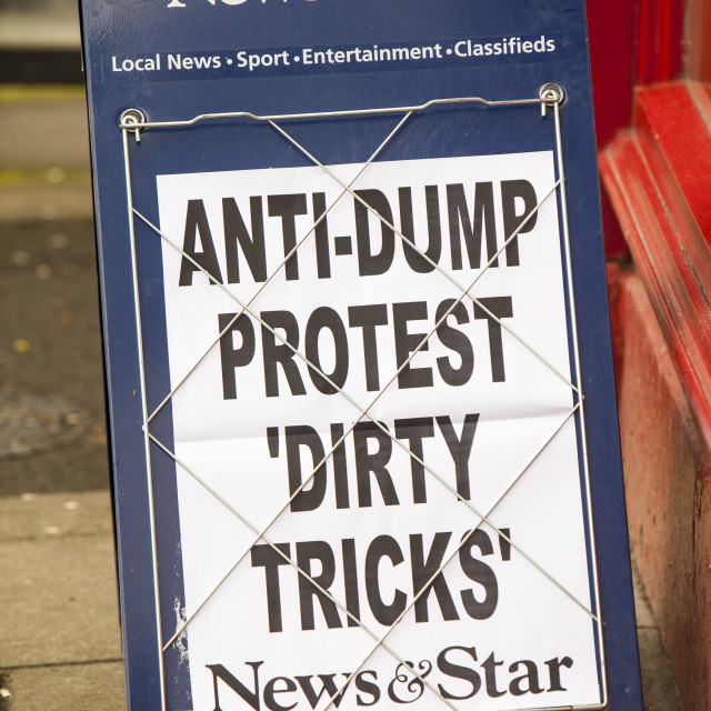 """""""A newspaper headline on hoardings in Cockermouth, about a potential nuclear..."""" stock image"""