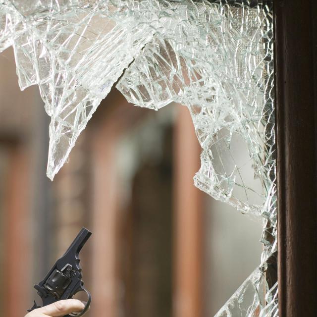 """""""A house break in in Carlisle Cumbria UK and a hand gun."""" stock image"""