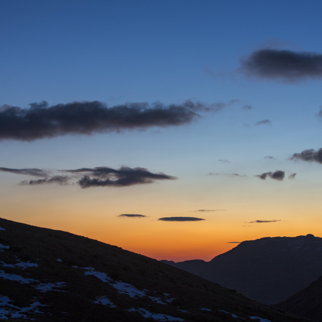 """""""Glowing light at dusk over Wrynose Pass in the Lake District, UK."""" stock image"""