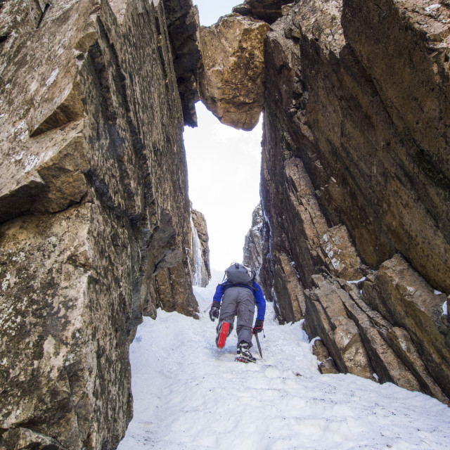 """A climber in Custs Gully on Great End, a grade one winter route, Lake..."" stock image"