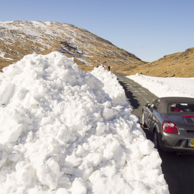 """""""Massive snow drifts on the side of the Wrynose Pass road in the Lake..."""" stock image"""