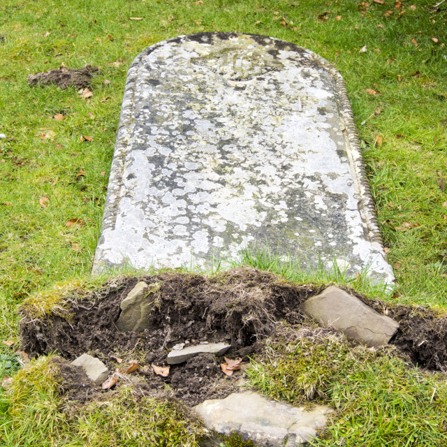 """""""Grave stones falling over in Stokesay church yard next to Stokesay Castle..."""" stock image"""