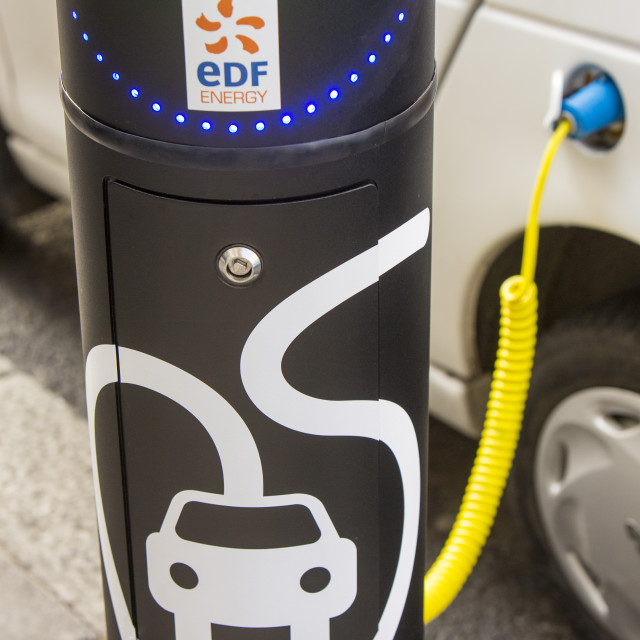 """""""A G Wizz electric car at a pavement recharging station in London."""" stock image"""