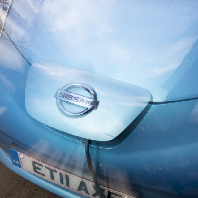 """""""A nissan Leaf, an electric car at a pavement recharging station in London."""" stock image"""