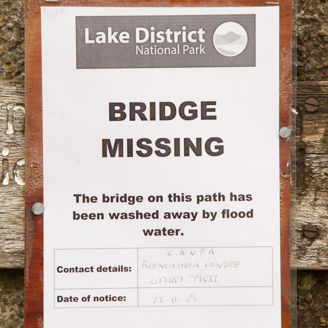 """""""A sign about the bridge over Newlands Beck near Braithwaite, Lake District,..."""" stock image"""
