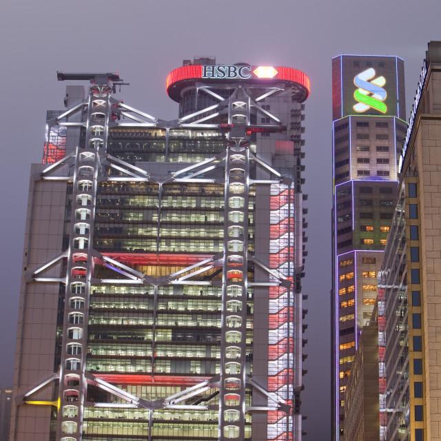 """""""HSBC bank in Hong Kong floodlit at night, China."""" stock image"""