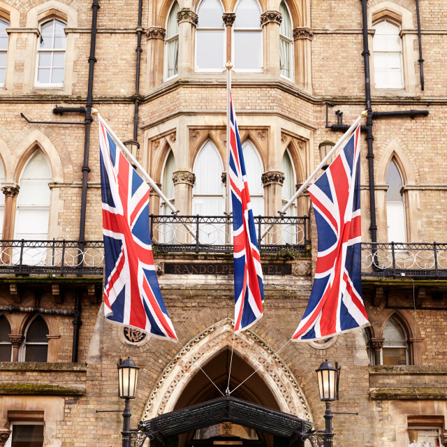 """OXFORD/ UK- OCTOBER 26 2016: Union Jack Flags Outside Randolph Hotel In Oxford"" stock image"