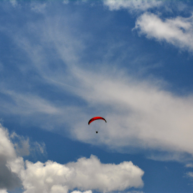 """Paragliding through the clouds"" stock image"