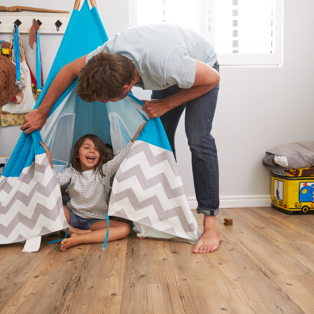 """Father And Daughter Playing In Wigwam In Playroom"" stock image"