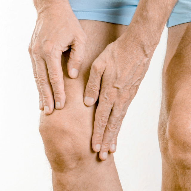 """""""Athlete man feeling pain to the knee and to the quadriceps"""" stock image"""