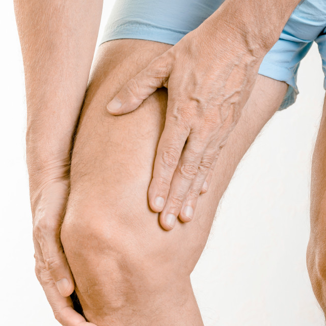 """""""Athlete man feeling pain to the quadriceps and to the knee"""" stock image"""