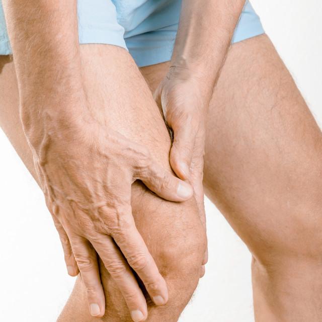 """Athlete man feeling pain to the knee"" stock image"