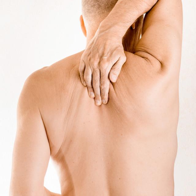"""Man suffering of thoracic vertebrae pain"" stock image"