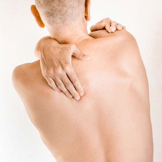 """""""Man suffering of thoracic vertebrae or trapezius muscle pain"""" stock image"""