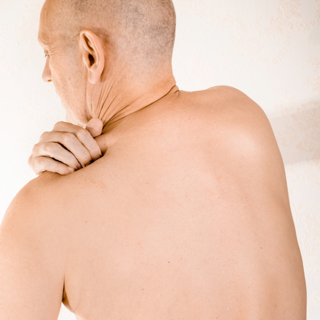 """Man suffering of trapezius muscle pain"" stock image"