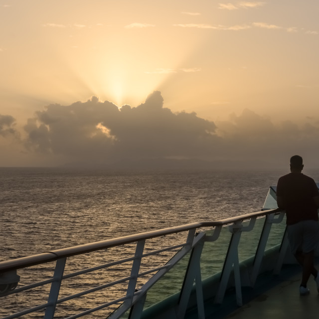 """Watching the Sunrise from a Ship"" stock image"
