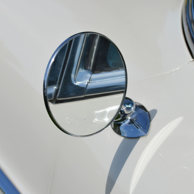 """Round chrome car wing mirror,"" stock image"