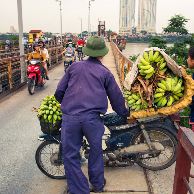 """HANOI, VIETNAM - Vietnamese banana seller entering"" stock image"