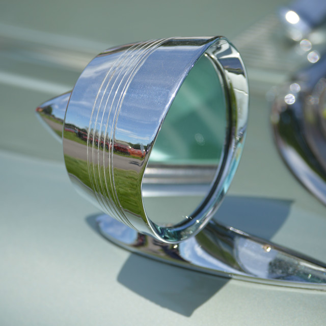 """Chrome wing mirror on a classic American car."" stock image"