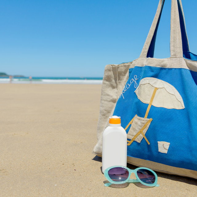 """Sun lotion and sunglasses in the beach"" stock image"