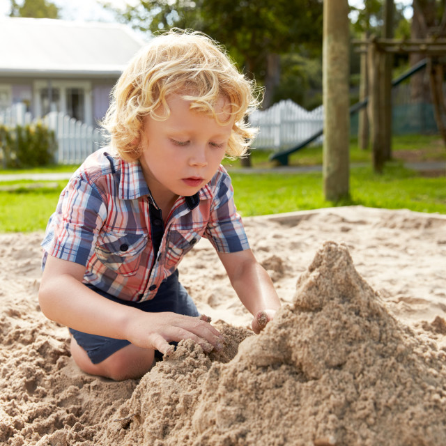 """Male Pupil At Montessori School Playing In Sand Pit At Breaktime"" stock image"