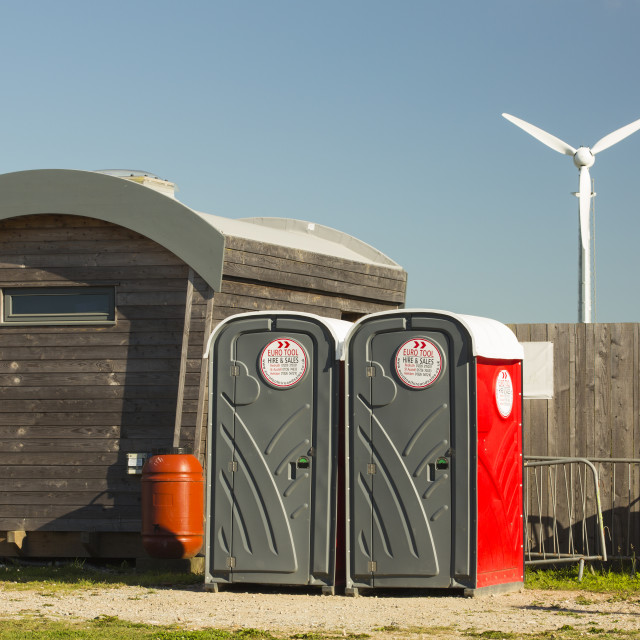 """""""Log cabins and a wind turbine at Mount Pleasant Ecological Park, Porthtowan,..."""" stock image"""