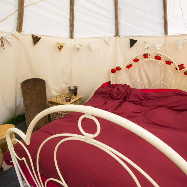 """""""A double bed in a wigwam used as the honeymoon suite for a green wedding at..."""" stock image"""
