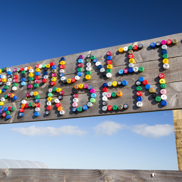 """""""The community garden spelt out with plastic bottle tops at Mount Pleasant..."""" stock image"""